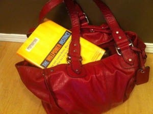 Donloree's giant purse with a book
